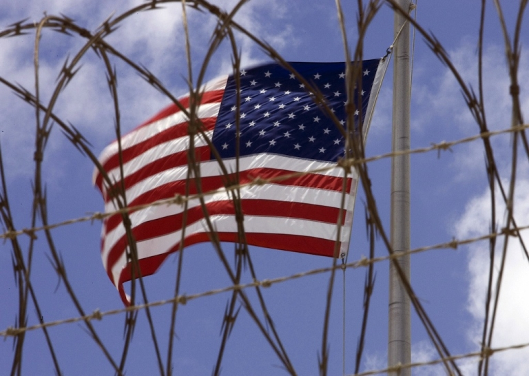 <p>A US flag flies at Camp V inside Camp Delta in US Naval Station in Guantanamo Bay, Cuba, 24 April 2007.</p>