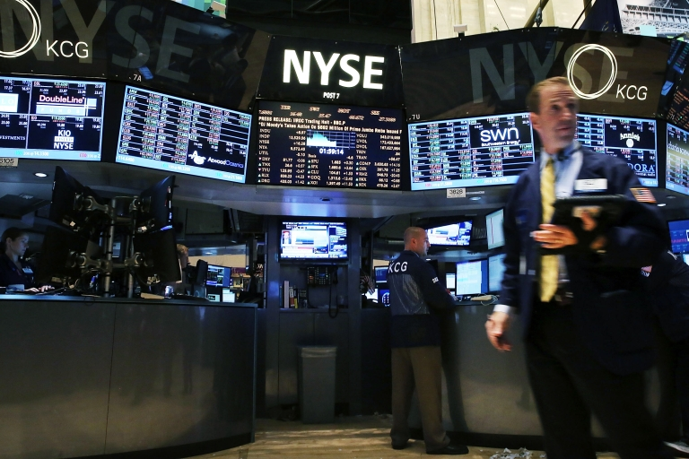 <p>Traders work on the floor of the New York Stock Exchange on July 31, 2013.</p>