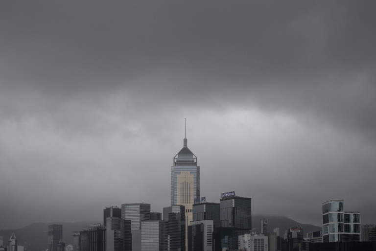 <p>Dark clouds brought by Typhoon Utor are seen over the city's skyline in Hong Kong on August 14, 2013. Hong Kong battened down as Typhoon Utor forced the closure of the city's financial market and schools and disrupted hundreds of flights after leaving several dead in the Philippines.</p>
