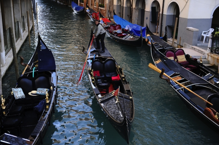 <p>A gondola passes on a canal in Venice on April 12, 2012.</p>