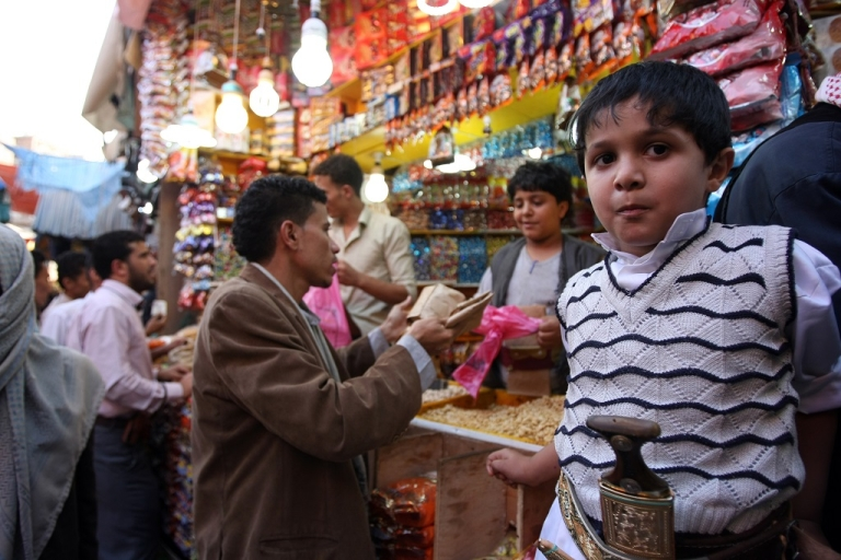 <p>Yemenis shop at a bazaar ahead of the upcoming Muslim Eid al-Fitr in Sanaa, on August 13, 2012. Muslims throughout the world prepare to celebrate the Eid al-Fitr festival at the end of the holy fasting month of Ramadan, in which they refrain from eating, drinking, smoking and sexual activities from dawn to dusk.</p>