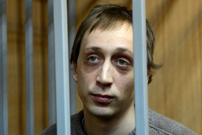 <p>Pavel Dmitrichenko, a leading dancer at Russias Bolshoi Theatre, looks on as he stands inside the defendant's cage during a court hearing in Moscow, on October 22, 2013.</p>