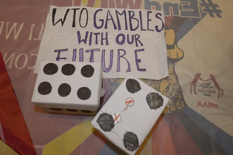<p>Fake dice are placed by activists from La Via Campesina while they hold a protest against the WTO at the 9th World Trade Organization (WTO) Ministerial Conference in Bali.</p>