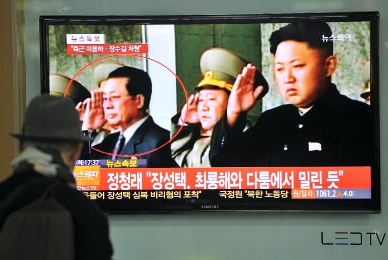 <p>South Korean TV reports on the dismissal of Jang Song Thaek (circled), the uncle of North Korean leader Kim Jong Un. North Korean state media confirmed his arrest on December 9, 2013, accusing him of