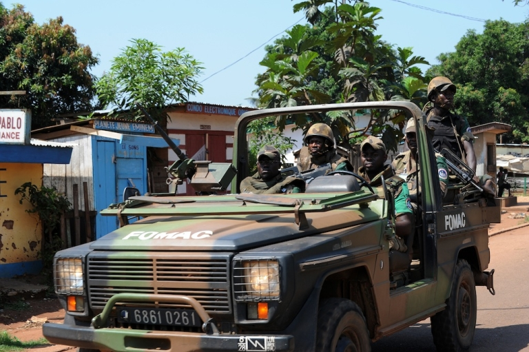 <p>Soldiers of the African-led International Support Mission to the Central African Republic (MISCA) patrol in the streets of Bangui on December 7, 2013.</p>