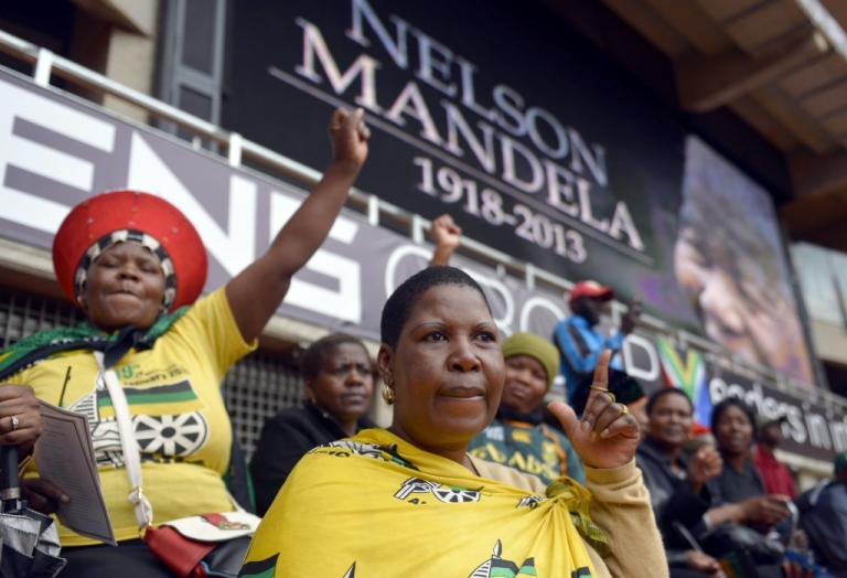 <p>South Africans attend the memorial service of former president Nelson Mandela at the FNB Stadium in Johannesburg on December 10, 2013. Mandela, revered icon of the anti-apartheid struggle, died in Johannesburg on December 5 at age 95.</p>
