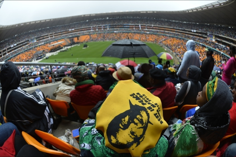 <p>Mourners attend the memorial service of former South African President Nelson Mandela at the FNB Stadium (Soccer City) in Johannesburg on Dec. 10, 2013.</p>