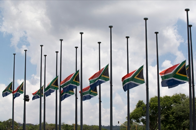 <p>South African flags fly at half-mast as the body of former South African president Nelson Mandela lies in state for a final day at Union Buildings in Pretoria on Dec. 13, 2013.</p>