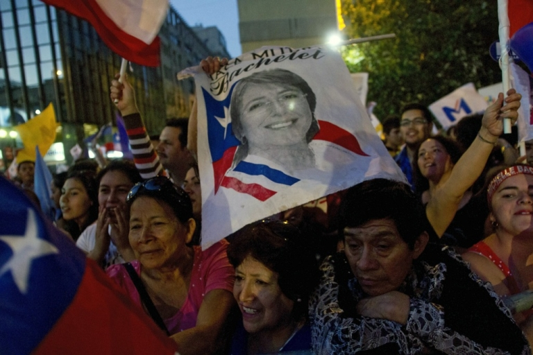 <p>Supporters of Chilean president-elect, Michelle Bachelet, celebrate after getting the results of the run-off presidential election in Santiago on December 15, 2013.</p>