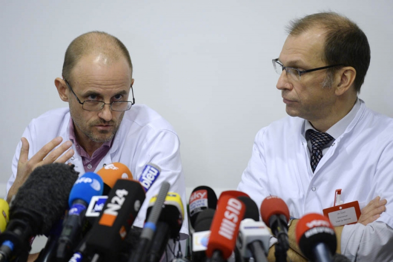 <p>Neurosurgeon professor Jean-Francois Payen speaks next to neurosurgeon chief Emmanuel Gay during a press conference about Michael Schumacher's health condition on December 31, 2013 at the Centre Hospitalier Universitaire hospital in Grenoble, French Alps. Doctors treating Michael Schumacher said Tuesday the Formula One legend has undergone a second operation following his life-threatening ski accident but warned he is
