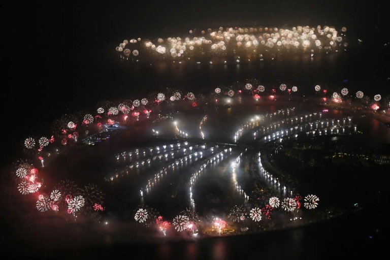 <p>Fireworks explode over Palm Jumeirah in Dubai on January 1, 2014 to celebrate the new year. The glittering fireworks display that lasted around six minutes spanned over 100 kilometers (60 miles) of the Dubai coast, which boasts an archipelago of man-made islands and the Burj Khalifa, the world's tallest tower.</p>