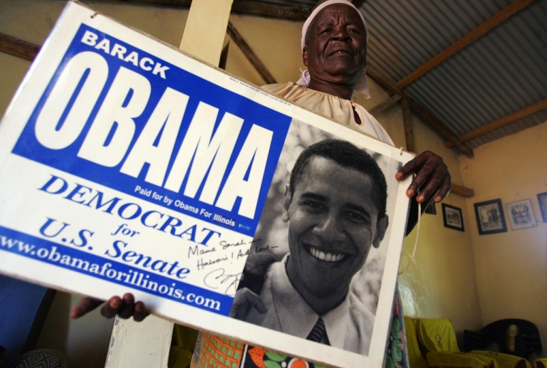 <p>Grandmother of US Presidential candidate and US Senator Barrack Obama, Sarah Obama Onyango holds a senate election placard promoting Obama at her home in the Kogelo Community in western Kenya 04 February 2008.</p>