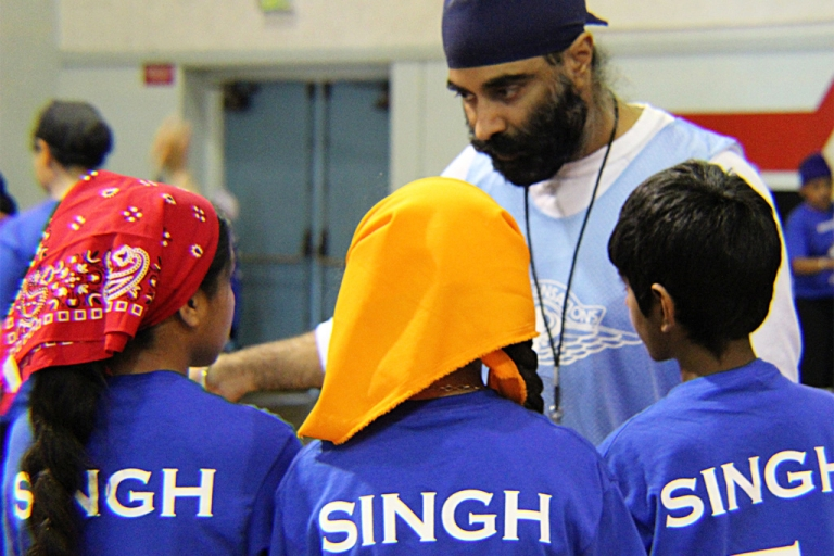 <p>Camp participants gather around a counselor at the second annual Sikh Sensations Basketball Camp in Los Angeles.</p>