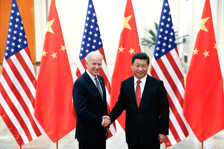 <p>Chinese President Xi Jinping shake hands with US Vice President Joe Biden inside the Great Hall of the People on December 4, 2013 in Beijing, China.</p>