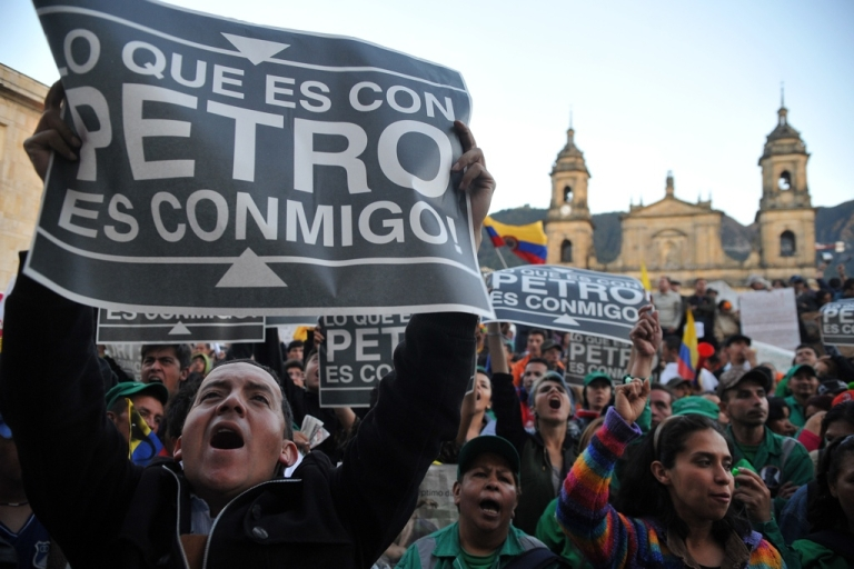 <p>Supporters of Bogota's sacked Mayor Gustavo Petro take part in a demo in downtown Bogota on Dec. 10.</p>