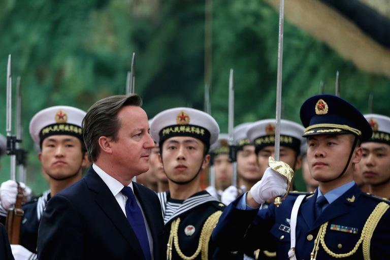 <p>Chinese Premier Li Keqiang invites British Prime Minister David Cameron to view an honor guard during a welcoming ceremony inside the Great Hall of the People on December 2, 2013 in Beijing, China.</p>