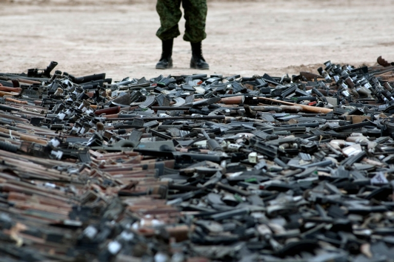 <p>Thousands of guns lie on the ground before their destruction in Ciudad Juarez, Chihuahua State, Mexico on Feb. 16, 2012. At least 6,000 rifles and pistols seized to drugs cartels were destroyed by members of the Mexican Army.</p>