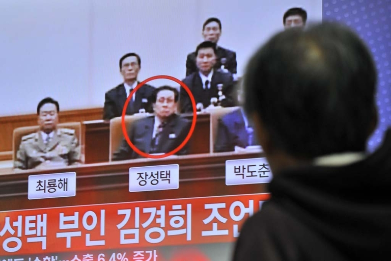<p>A South Korean man watches TV news about the alleged dismissal of Jang Song Thaek, North Korean leader Kim Jong-Un's uncle, at a railway station in Seoul on Dec. 3, 2013.</p>
