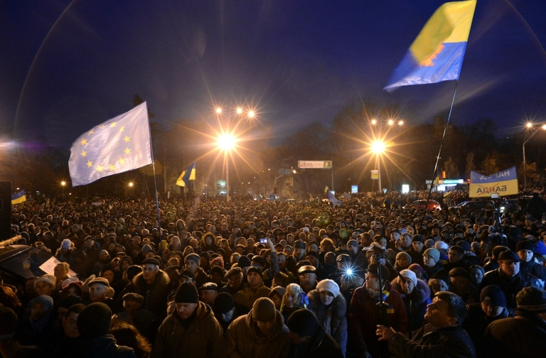 <p>Ukrainian protesters wave an EU flag as hundreds gather for an opposition rally in Mykhayllivska Square in Kiev after police dispersed protesters in Independence Square on Nov 30, 2013.</p>