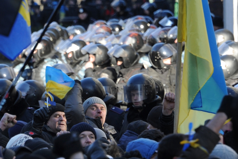 <p>Protesters and riot police outside parliament on Tuesday.</p>