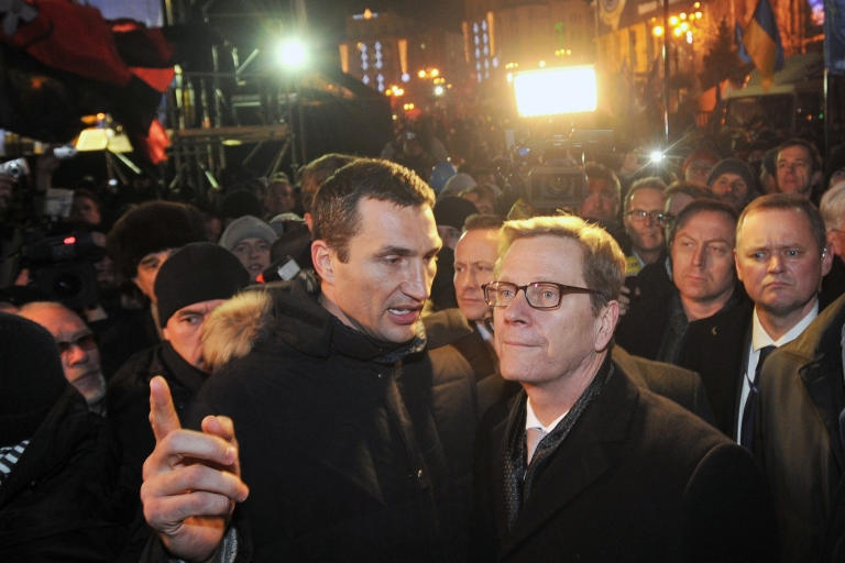 <p>German Foreign Minister Guido Westerwelle (R) with Ukrainian boxing champion Wladimir Klitschko, brother of opposition leader Vitali, during an opposition rally in Kiev on Wednesday. Westerwelle said the gates of Europe are still open for Ukraine.</p>