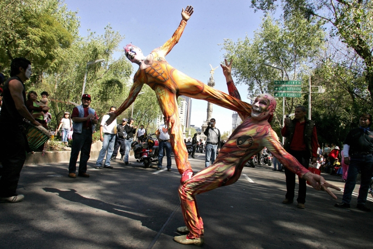 <p>Mexico City, MEXICO:  Jugglers perform during the Epiphany Day parade in Mexico City, 06 January 2007. This Christian holiday honors the Biblical story of the three kings who traveled to the town of Bethlehem to present their gifts to baby Jesus. AFP PHOTO/Alfredo ESTRELLA  (Photo credit should read ALFREDO ESTRELLA/AFP/Getty Images)</p>