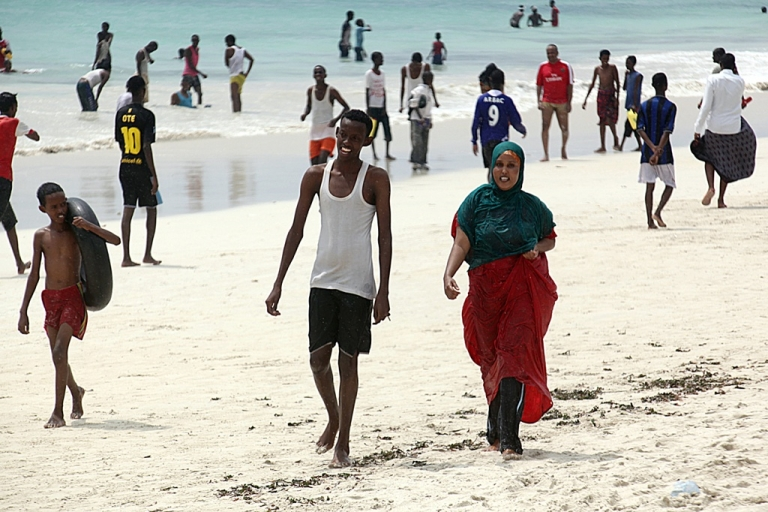 <p>Somali youths walk and play along the beach on the outskirts of Mogadishu on Nov. 18, 2011.</p>