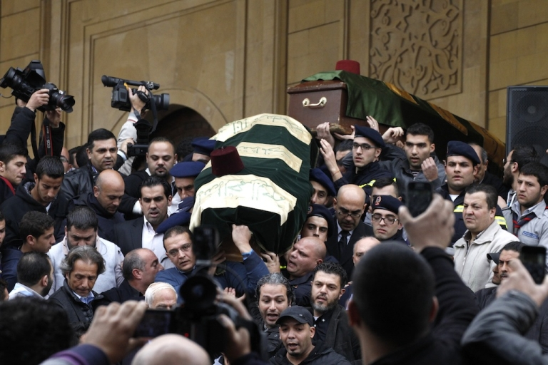 <p>The coffin of former Lebanese finance minister Mohammad Shatah is carried out of a mosque during their funeral in downtown Beirut, on Dec. 29, 2013.</p>