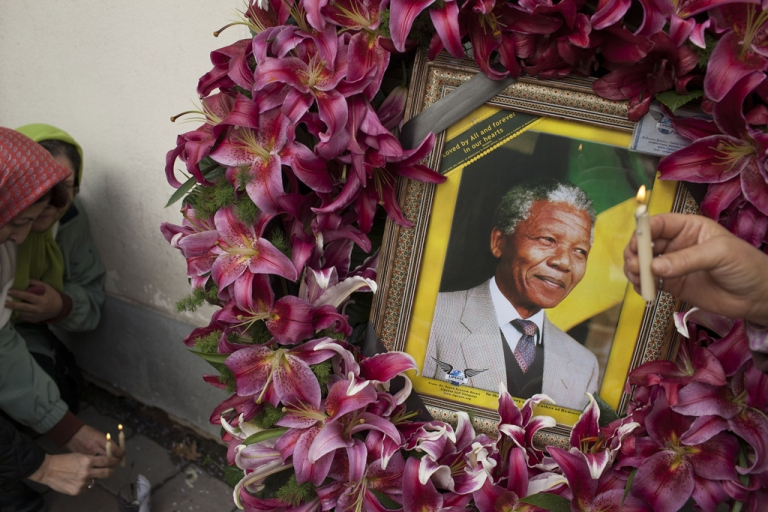 <p>Mourners gather in front of the South African embassy to pay their respects to the memory of Nelson Mandela on Dec. 7, 2013 in Tehran, Iran.</p>