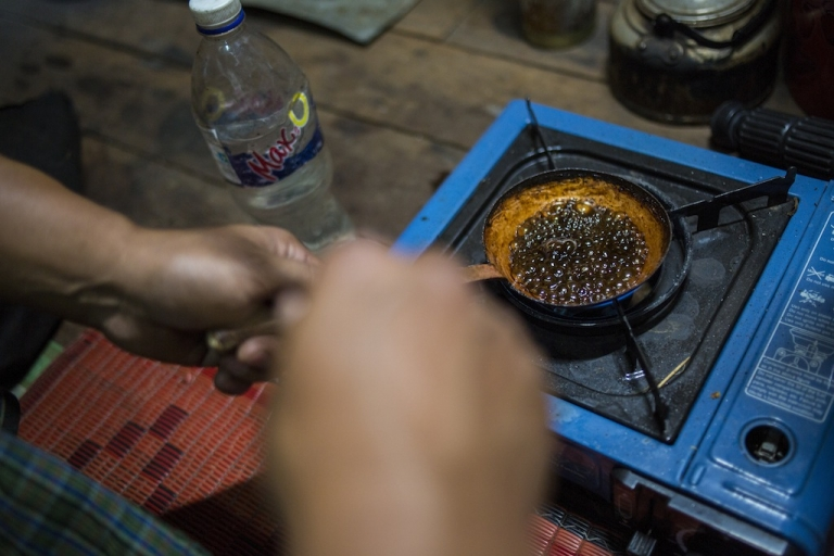 <p>A drug user prepares opium. Here in northern Myanmar men descend into the jade mines to escape poverty. Instead, most end up heroin addicts, and the drug dealers and middlemen get rich.</p>