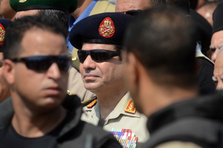 <p>General Abdel Fattah el-Sisi attends the funeral of Giza security chief Nabil Farrag in the district of Giza, on the outskirts of Cairo, on September 20, 2013.</p>