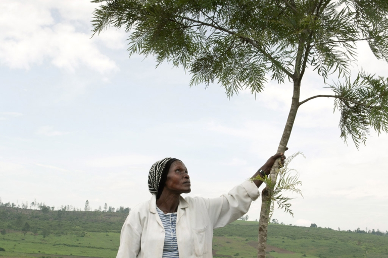 <p>Jeanne d'Arc Mukarenyange an ex-FAR soldier and a reservist for RPF is a member of farming cooperative for veterans. Jeanne stands on the collectives farmland in Kigali, Rwanda.</p>