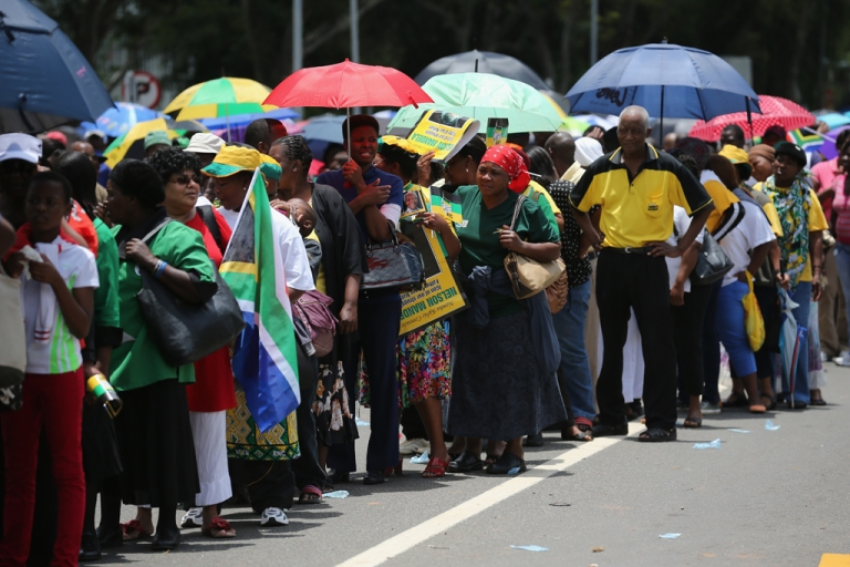 <p>Thousands of people wait in line to view former South African president Nelson Mandela as he lies in state for three days at Union Buildings on December 11, 2013 in Pretoria, South Africa.</p>