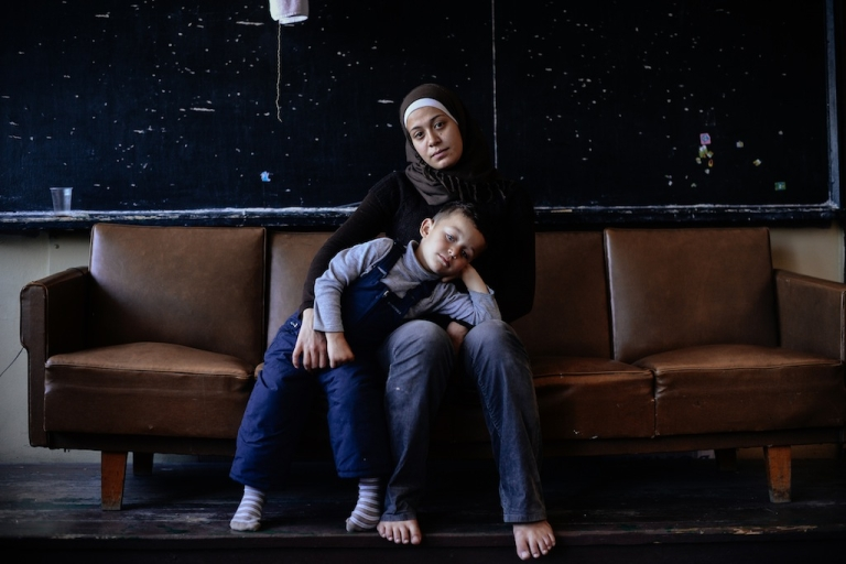 <p>A Syrian woman poses for a photo with her four-year-old son at the Vrazhdebna refugee centre in the Bulgarian capital of Sofia on Oct. 24, 2013.</p>