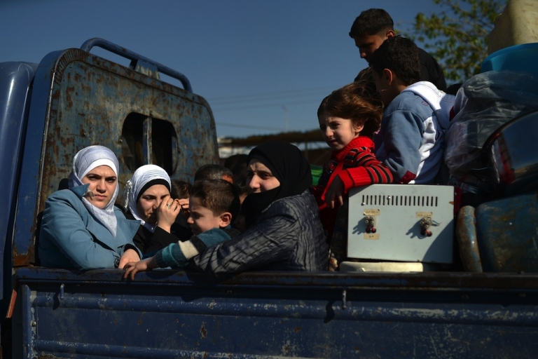 <p>Syrian civilians flee the northern Syrian city of Aleppo on April 12, 2013.</p>