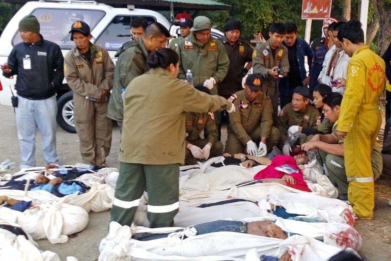 <p>Members of Thai rescue team inspect the bodies of passengers killed in road accident in Phetchabun province on Dec. 27, 2013. A bus carrying New Year travellers plunged off one of Thailand's highest bridges, killing at least 29 people.</p>