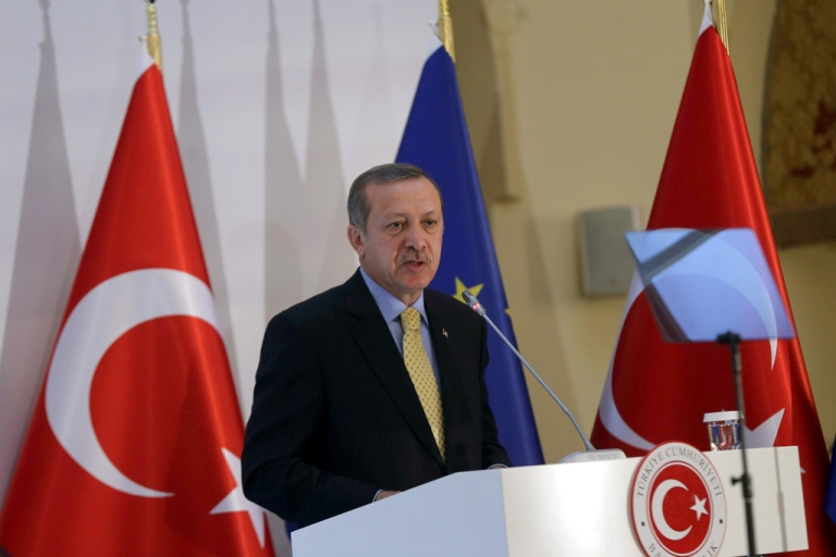 <p>Turkey's Prime Minister Recep Tayyip Erdogan delivers a speech during the Turkey-EU readmission agreement signing ceremony in Ankara on December 16, 2013.</p>