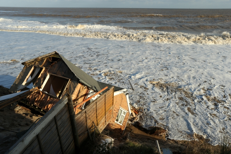 <p>The scene where properties have fallen into the sea due to the cliff collapsing on December 6, 2013 in Hemsby, England. Thousands of people were evacuated from their homes as a deadly winter storm and the highest tidal surge in 60 years hit east coast towns overnight, causing flooding and damage in many areas.</p>