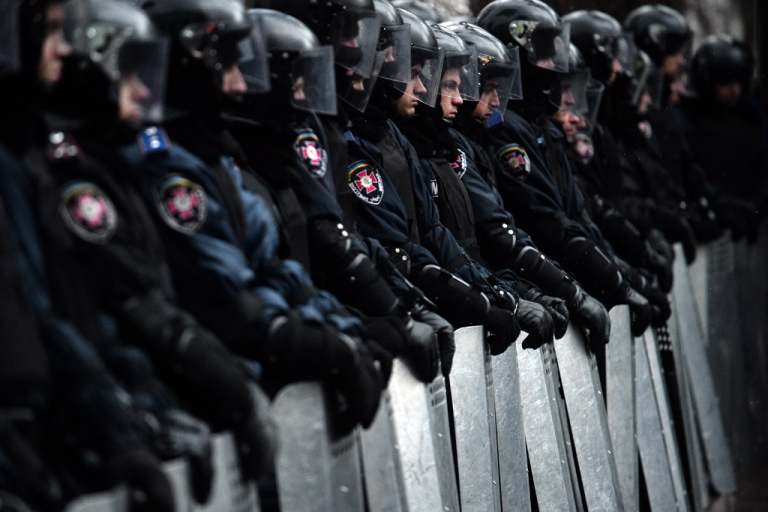 <p>Riot police stand guard in front of Ukrainian parliament after a mass rally called