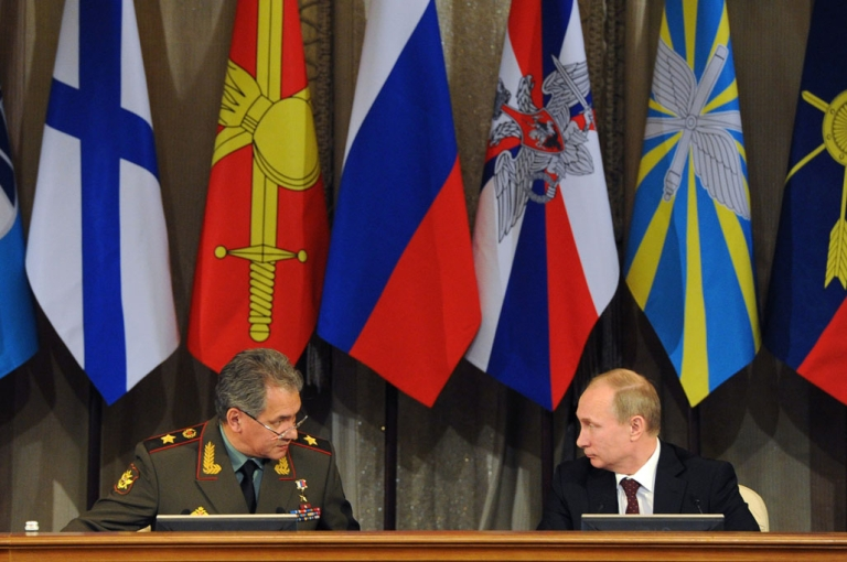 <p>Russian Defence Minister Sergei Shoigu, left, and President Vladimir Putin speak during a defence ministry meeting in Moscow on December 10, 2013. Putin ordered today Russia's military to step up its presence in the Arctic after Canada signalled its intention to claim the North Pole and surrounding waters.</p>
