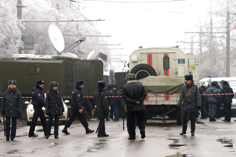 <p>Russian policemen guard the site of a deadly bombing on a packed trolleybus in Volgograd on December 30, 2013.</p>