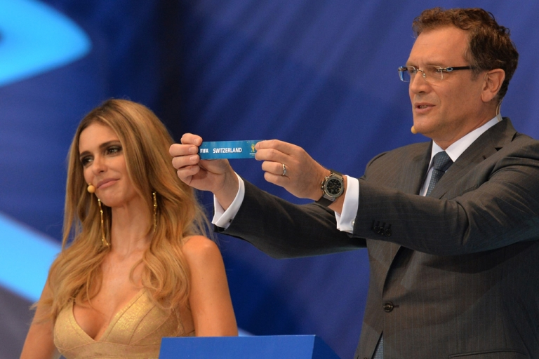 <p>FIFA Secretary General Jerome Valcke shows the name of Switzerland next to presenter Fernanda Lima during the final draw of the groups for the Brazil 2014 FIFA World Cup on December 6, 2013 in , in Costa do Sauipe.</p>