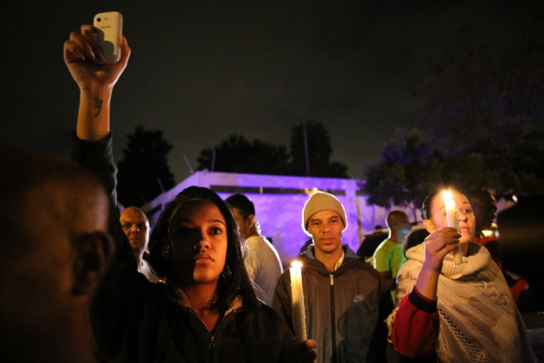 <p>South Africans hold a candlelight vigil outside the house of former South African president Nelson Mandela following his death in Johannesburg on December 5, 2013.</p>