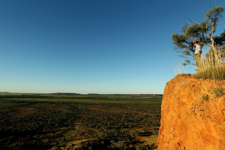 <p>Station owner Charlie Phillott looks out from a cliff on his land in Winton, outback Australia.</p>