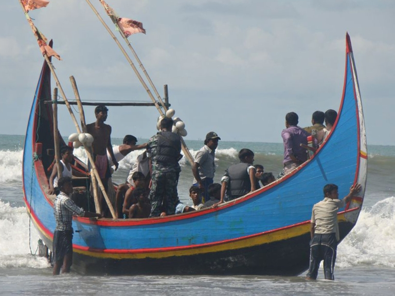 <p>Rohingya refugees, who survived after their overloaded boat heading to Malaysia sank, are pictured on a fishing boat following their rescue by Bangladeshi border guards in Teknaf on November 7, 2012. About 85 people are missing after an overloaded boat carrying Rohingya refugees towards Malaysia sank off Bangladesh early on November 7, the second such tragedy in less than a fortnight, officials said.</p>