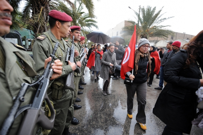 <p>Tunisian soldiers stand guard during opposition leader Chokri Belaid's funeral procession through the capital. At least eight soldiers were killed on July 29, 2013 during a mountain ambush, just five days after another Tunisian opposition leader, Mohamed Brahmi, was shot dead in front of his house.</p>