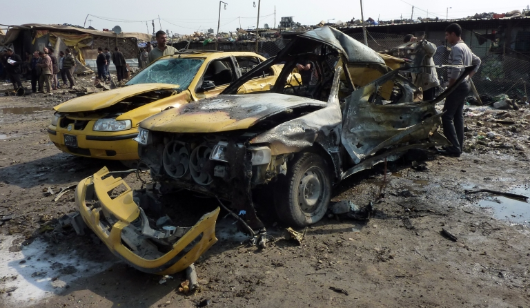 <p>Destroyed cars lie at the scene of an explosion at the bird market in the north Baghdad Shiite neighbourhood of Kadhimiyah on February 8, 2013. A spate of car bombs in Shiite areas of Iraq, including two blasts minutes apart at a popular bird market, killed at least 29 people, the latest in a spike in violence amid a political crisis. The attacks, which left nearly 70 others wounded, primarily targeted marketplaces that are often crowded on Fridays, the weekly holiday in Iraq, and took the death toll from a week of violence to more than 100.</p>