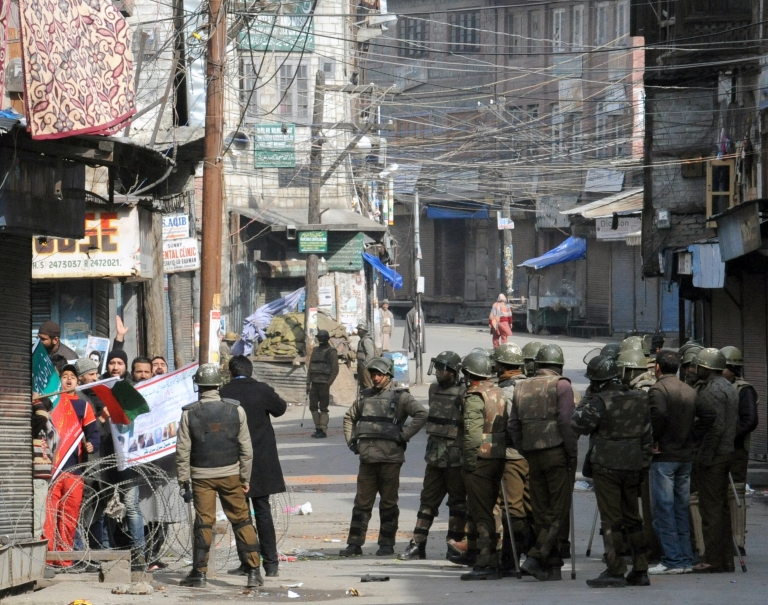 <p>Activists defy a curfew in Kashmir Valley on Feb. 11, 2013.</p>