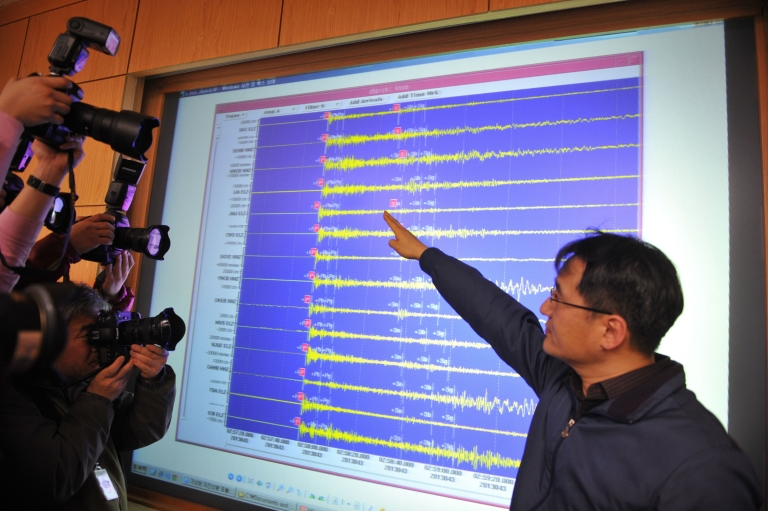 <p>An official of the Korea Meteorological Administration shows a seismic image of a tremor caused by North Korea's nuclear test, in Seoul on February 12, 2013. North Korea staged its most powerful nuclear test yet, claiming a breakthrough with a 'miniaturised' device in a striking act of defiance to global powers including its sole patron China.</p>