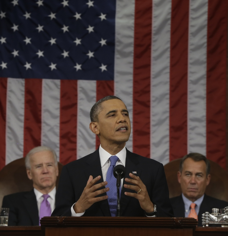 <p>President Barack Obama, flanked by Vice President Joe Biden and House Speaker John Boehner of Ohio, gestures during the State of the Union address before a joint session of Congress on Capitol Hill in Washington, Tuesday Feb. 12, 2013.</p>